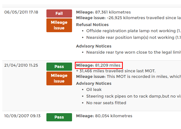 An MOT record showing a mileage reduction due to mix of odometer formats.